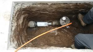 square hole dug for pipe bursting equipment