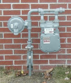 gas pressure regulator beside gas meter